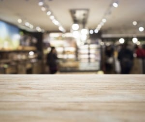 Table top with Blurred Retail shop Interior decoration background